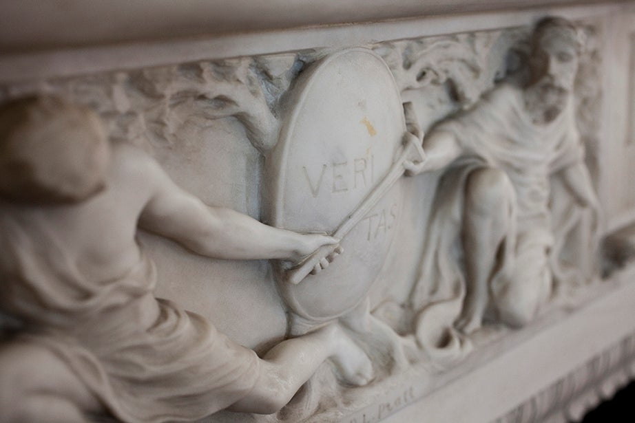 A decorative marble molding in the dining room mantelpiece of Loeb House features the Veritas seal.
