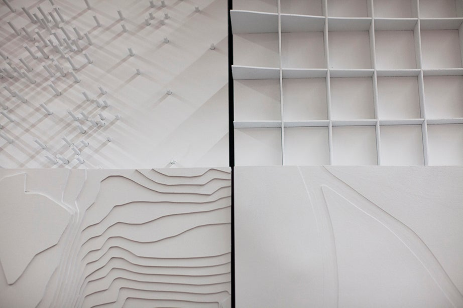 """Four types of topographic maps are on display in the """"Cartographic Grounds"""" exhibit at the Graduate School of Design."""