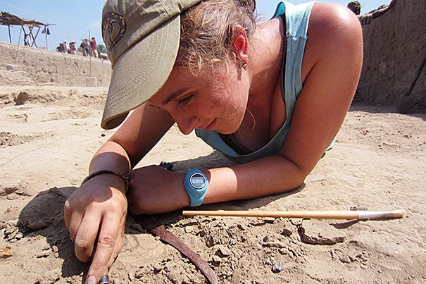 Harvard College student Sarah Joy Martini '16 excavates llama bones at the Archaeology Field School at San José de Moro, Peru (photo 1). A tower at the Moche archaeological site (photo 2) helps researchers get a bird's-eye view of the ongoing work. The ancient burial tomb of the eighth priestess of Moro (photo 3). Photo by Luis-Jaime Castillo-Butters