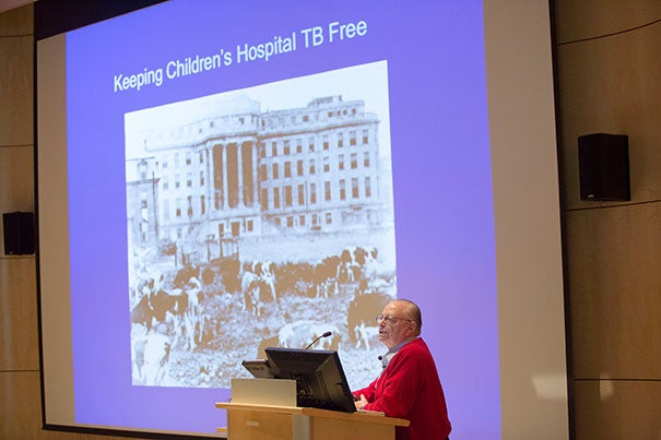 "Barry Bloom offered reflections on TB research during the ""TB in the 21st Century"" symposium, which honored HSPH's 100th anniversary (photo 1). Gokhan Hotamisligil, chair of the School's Department of Genetics and Complex Diseases, focused in part on the obesity epidemic and the link between metabolism and immunity (photo 2), while Associate Professor Sarah Fortune pointed out that the No. 1 risk factor for TB globally was not HIV, but diabetes."