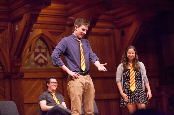 Ari Brenner '14 (from left), Jake Silberg '15, and Libby Coleman '15, members of the Immediate Gratification Players, acted out topics that typically arise between freshmen and their parents (photo 1). Interim College Dean Donald Pfister (photo 2) welcomed parents at a packed Sanders Theatre (photo 3).