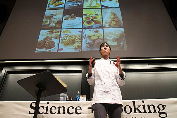 Before a packed house, Joanne Chang '91 (photo 1) demonstrated a simple baking technique with caramelized sugar, creating a spun-sugar net on a tower of cream puffs, known as croquembouche (photo 2, 3).
