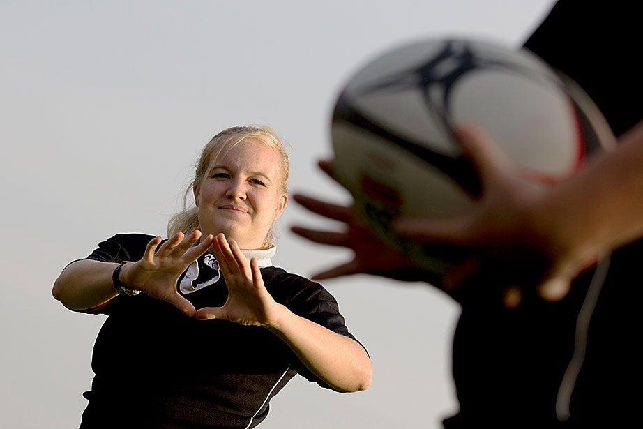 Helen Clark works on her catching technique in practice.