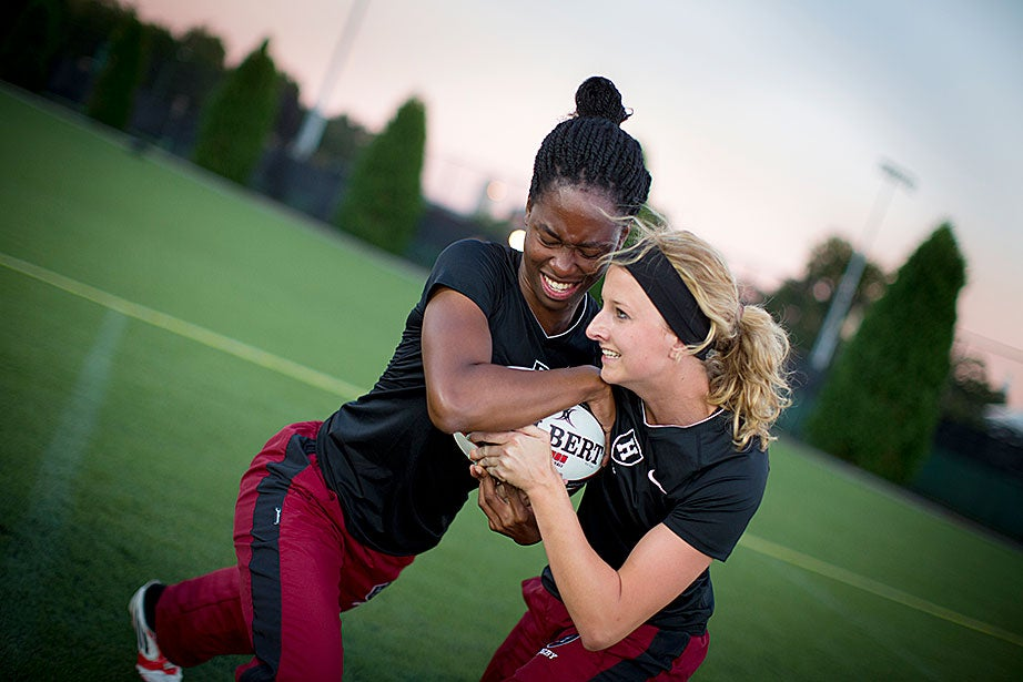 Aniebiet Abasi (left) and Kaleigh Henry focus on improving strength in a pushing drill.