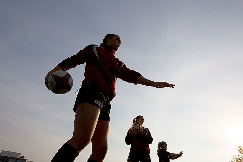Audrey Carson, foreground, and others work on passing techniques.
