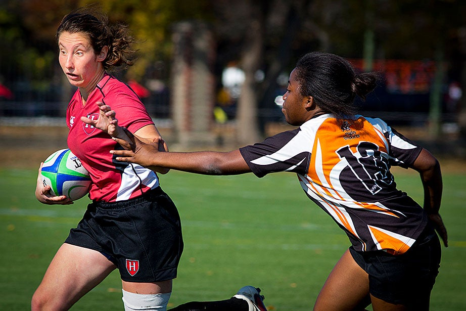 Xanni Brown (left) evades a Princeton defender in a match. Harvard won, 36-0.