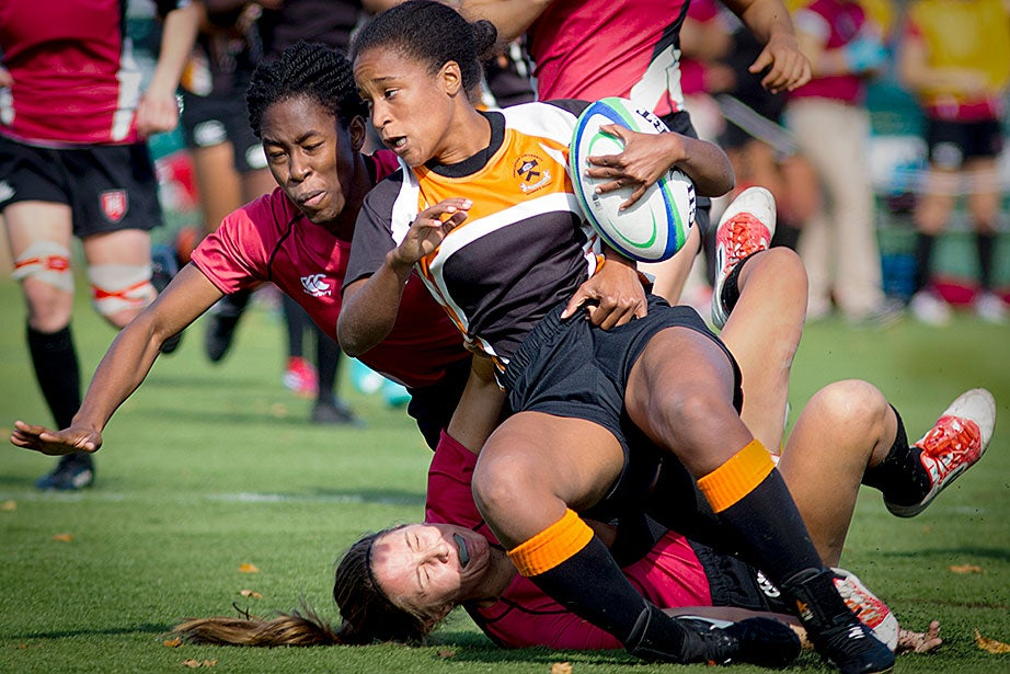 Harvard defenders Aniebiet Abasi (top) and Audrey Carson (bottom) take a down a Princeton player (with ball).