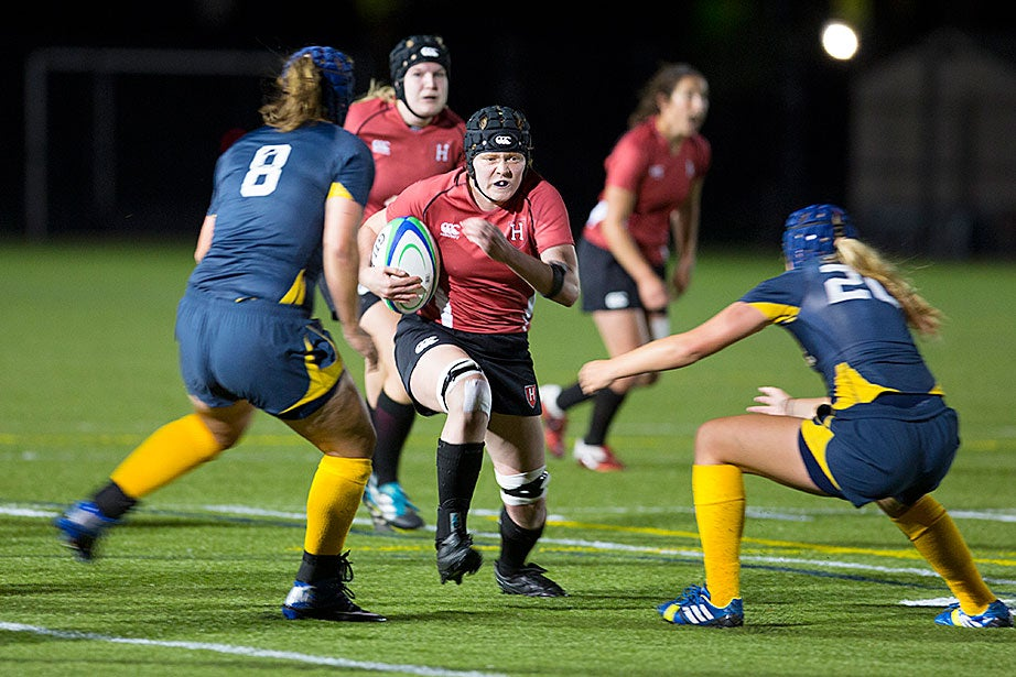 Ball carrier Madison Singell gains yardage against Quinnipiac. Rugby is the only full-contact women's sport at Harvard.