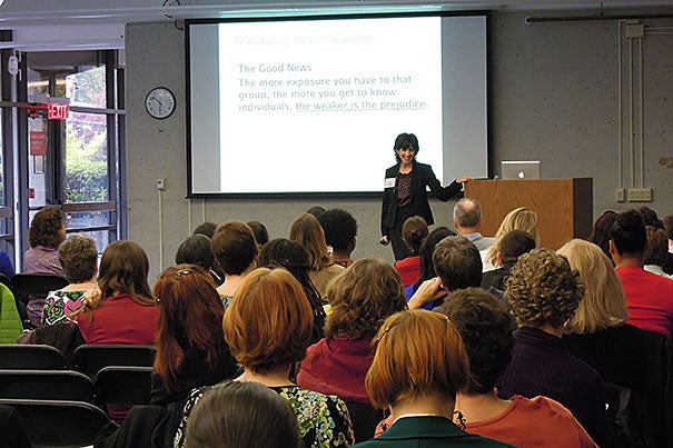 """In the first of three FAS diversity dialogues,  Gail Price-Wise (photo 1) told her Harvard audience that no one wants to admit that he or she has prejudice, and no one wants to be the target of it, but """"we all have prejudice."""" Price-Wise's remarks sparked conversation among the groups (photo 2)."""
