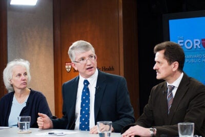 "A lack of ""surge"" capacity plagues pandemic flu preparations around the world, agreed a panel at the Harvard School of Public Health. ""There's just little wiggle room in today's health care system,"" said Anita Barry (from left), the director of Boston's Infectious Disease Bureau. Robert Huebner and Klaus Stohr noted that national borders — whether closed in an emergency or not — are not a defense against a pandemic. Harvard Professor Marc Lipsitch (not pictured) also joined the discussion."