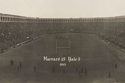 A detail from a panoramic photograph taken at the 1913 Harvard-Yale game at Harvard Stadium. The stadium was full to capacity with some spectators standing on the roof over the bleachers. Harvard won, as noted on the photograph, 15 to 5.