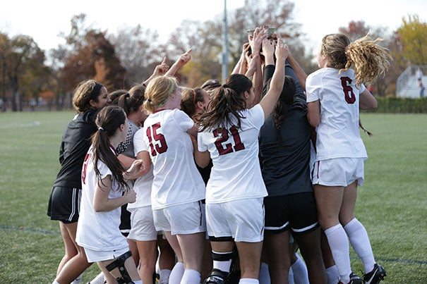 Harvard celebrates its victory over Dartmouth, securing its 11th Ivy League Championship.