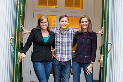 """Harvard Business School students Amanda Burlison (left) and Alexandra Daum are co-presidents of the Women's Student Association, which has now begun including male members, known as """"manbassadors,"""" like Daniel Samit (center). """"One of our goals is absolutely to give an outlet to men who are passionate and interested in getting involved,"""" said Burlison."""