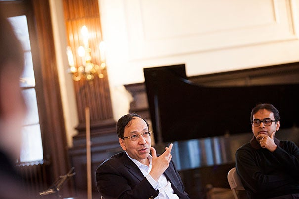 "Sugata Bose (left) discussed a new composition inspired by the Ganges River with Sandeep Das (photo 1). During the Silk Road Ensemble's three-day residency at Harvard, Bose offered suggestions to Japanese flutist Kojiro Umezaki (photo 2). ""We are trying as an organization to go just beyond the Silk Road trade route and think about it more as just a metaphor,"" said violinist and composer Colin Jacobsen (photo 3)."
