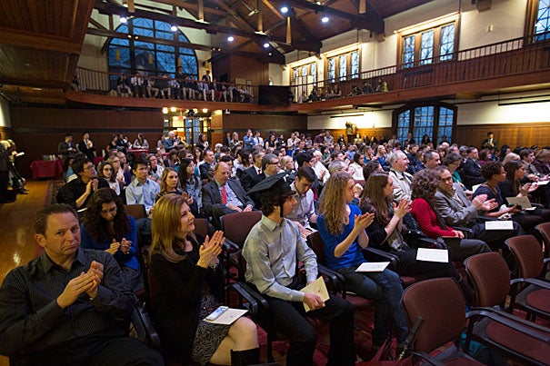 "Surrounded by family and friends, 111 Harvard College undergraduates were honored on Tuesday during ceremonies at the Knafel Center (photo 1). Interim Dean of Harvard College Donald Pfister (photo 2) noted that graduating midyear may be out of step with the tradition of Commencement, but as graduate Alexander Wells '13 (photo 3) remarked in his speech, ""being out of phase"" is something that has provided comfort to him."