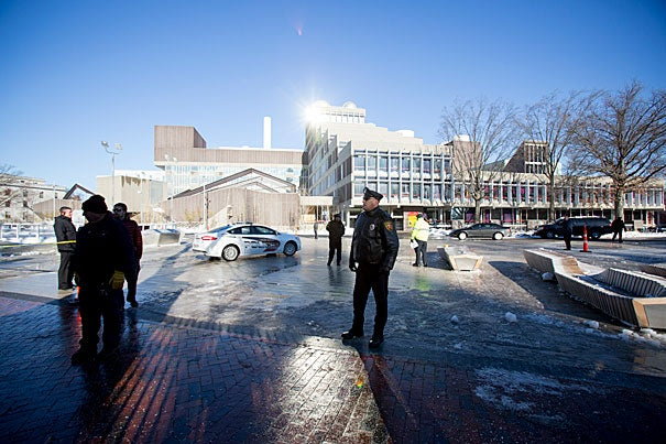 The Yard was restricted to Harvard ID holders for several hours but all four buildings were cleared and reopened by shortly before 3 p.m., as campus life returned to normal on the first day of final exams. President Drew Faust (photo 2) chatted with students temporarily relocated to Annenberg Hall.