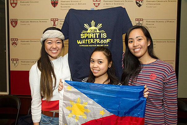 """""""Being so far away, I feel that the distance makes it really difficult to fully comprehend what has happened and what is going on in terms of relief efforts,"""" said Michelle Ferreol '15 (right), who, along with fellow Harvard Philippine Forum members Shannen Kim '15 (left) and Riana Jumamil '14, is launching a T-shirt line to further fundraising efforts for those affected by Typhoon Haiyan."""