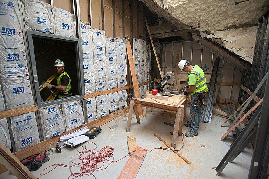 Carpenter Dennis Kotarac works in what will be a common room in McKinlock.