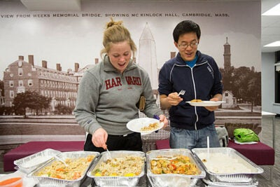 Leverett House Giant Study Break. Kathleen Hanley '16, left, and Yuechen Zhao '15 sample Thai food at Leverett G-Hutch. Jon Chase/Harvard Staff Photographer