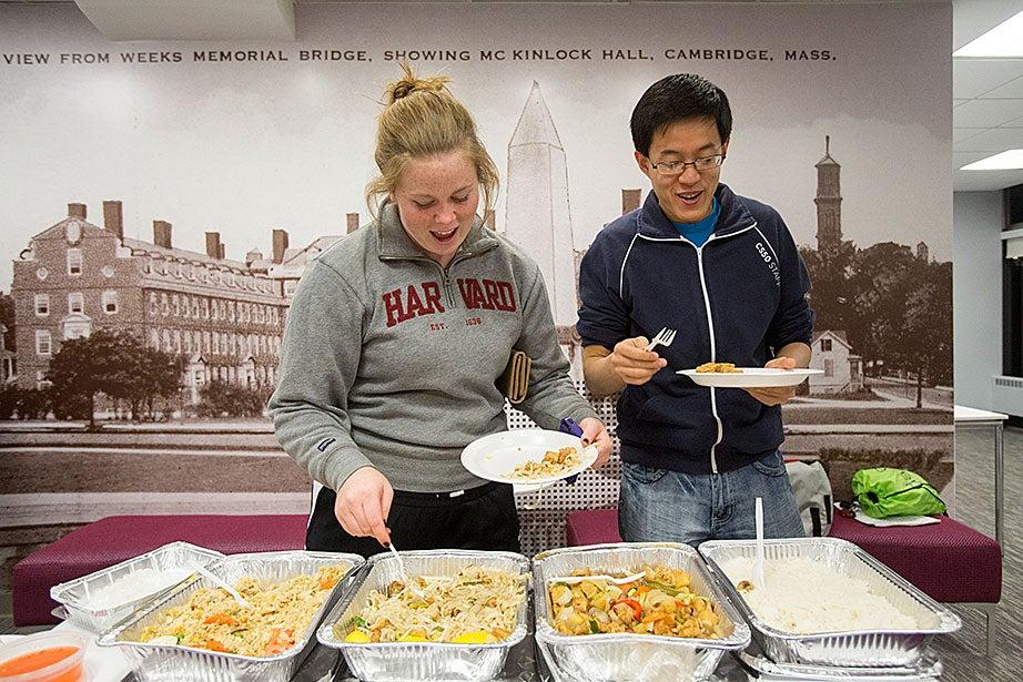 """Leverett House """"Giant Study Break"""": Kathleen Hanley '16 and Yuechen Zhao '15 sample Thai food at Leverett G-Hutch."""
