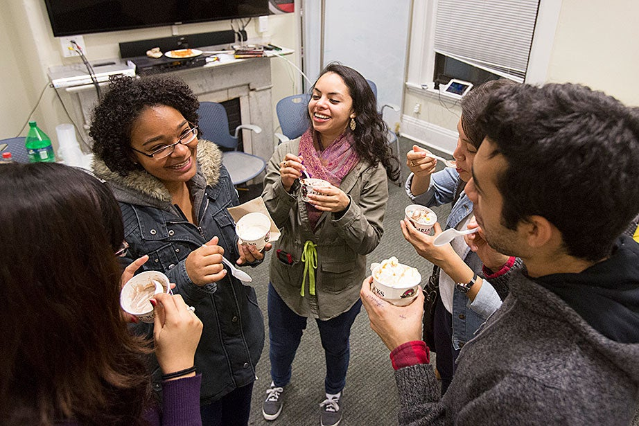 "Leverett House ""Giant Study Break"": Daily Guerrero (second from left) and Diana Acosta '14 (center) join housemates for ice cream from J.P. Licks at Fairfax swing housing."