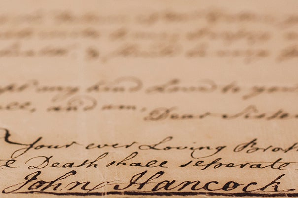A signature by John Hancock is pictured from the collections at Harvard Archives at Harvard University. Stephanie Mitchell/Harvard Staff Photographer