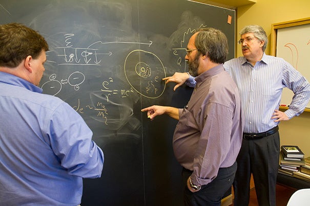 Yale's David DeMille (from left), and Harvard professors Gerald Gabrielse and John Doyle are known as the ACME team. Together, the researchers recorded the most sensitive measurements to date of electron deformation.