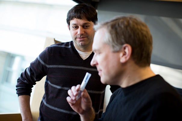 Associate Professor of Cell Biology Stephen Liberles (left) and research associate Mark Fletcher put the smell of rotting flesh to the test. The question they're exploring is why a particular scent repels some animals and attracts others.