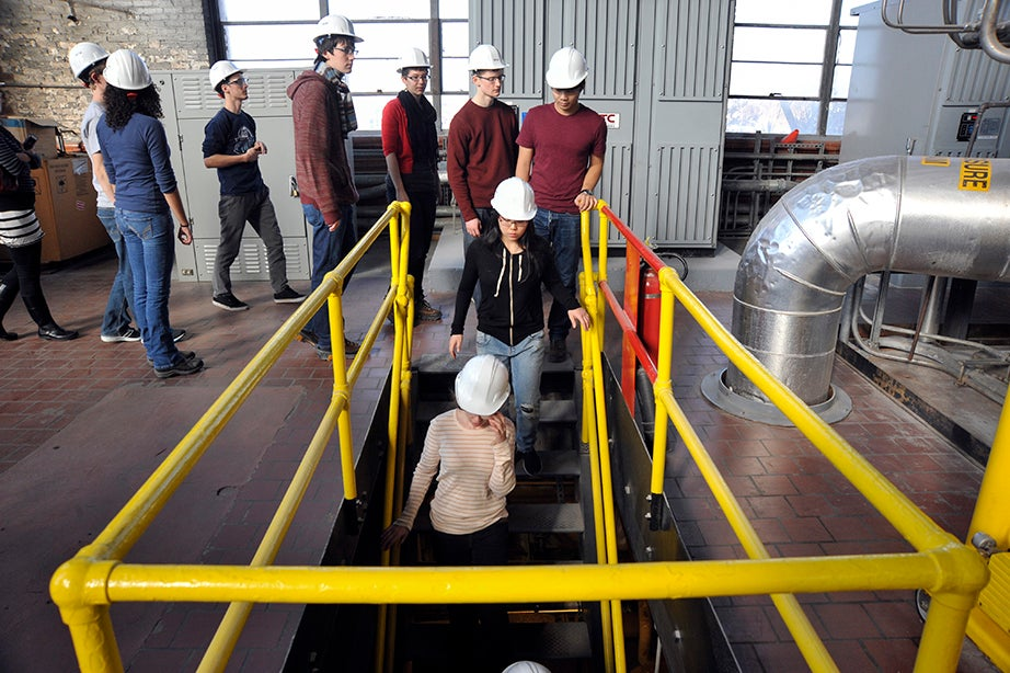 Students examine energy-efficiency upgrades, boilers, and a steam turbine generator at work, and take a walk through the tunnels during a tour of the steam plant at 46 Blackstone St. Jon Chase/Harvard Staff Photographer