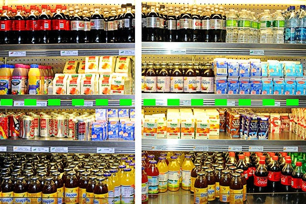 """Before MGH changed its cafeteria to conform to  """"traffic light"""" labels and product placement, sugar-sweetened soft drinks and juices were mixed together with diet beverages and low-fat dairy items (left). After the implementation (right), water, diet beverages, and other healthy choices are now placed at or above eye level (dotted line), while less healthy items are below."""