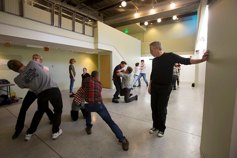 Instructor Bob Walsh (right) watches as Harvard students stage a combat scene at Arts@29Garden. Rose Lincoln/Harvard Staff Photographer