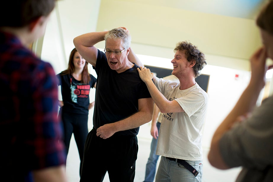 """Gareth Haslam '17 (right) learns how to do a """"hair pull"""" during the """"Direct, Design, Perform: Reinventing the Stage in One Act"""" session. Rose Lincoln/Harvard Staff Photographer"""