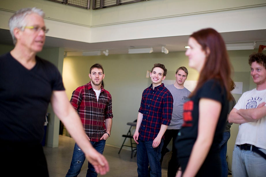 Students watch Bob Walsh (left) and his assistant Ellen Bryan (right) demonstrate fight moves. Rose Lincoln/Harvard Staff Photographer