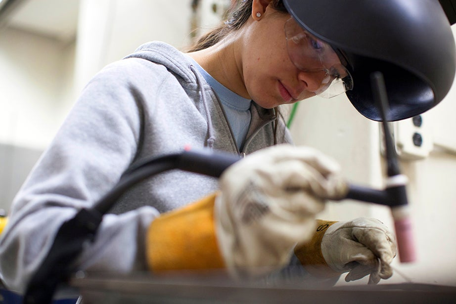 Graduate student Paola Mariselli, a computer science concentrator, took advantage of Wintersession to learn about welding. Stephanie Mitchell/Harvard Staff Photographer