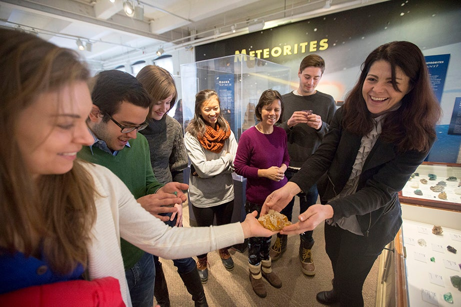 Raquel Alonso-Perez, curator of the Harvard Mineralogical and Geological Museum (right), gives Brielle Bryan (from left), a Ph.D. candidate at the Graduate School of Arts and Sciences, Eduardo Cabral '16, Haley Adams '15, Julianne Chu '15, Aurielia Engel, a museum studies student in the Extension School, and Stefan Skalbania '15 an opportunity to examine the geology collection hands-on. Kris Snibbe/Harvard Staff Photographer