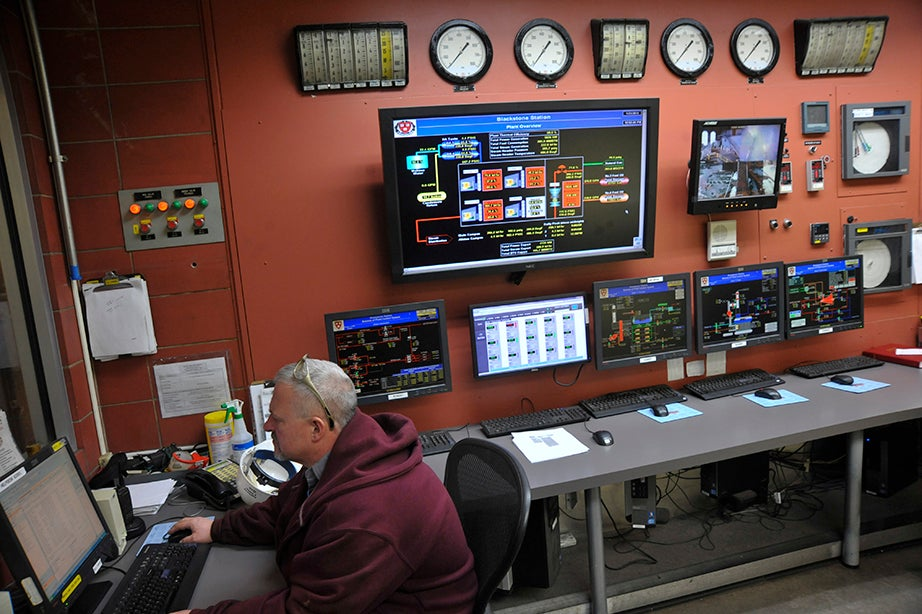 An operator in the control room monitors activity at the Blackstone Steam Plant. Jon Chase/Harvard Staff Photographer