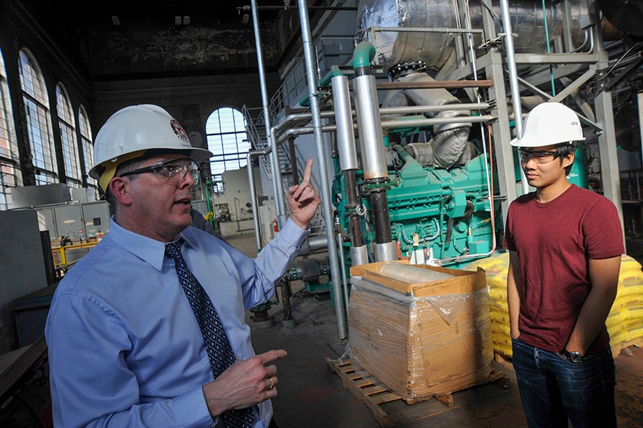 Bob Manning, director of engineering and utilities, leads students on a tour of the steam plant. Jon Chase/Harvard Staff Photographer