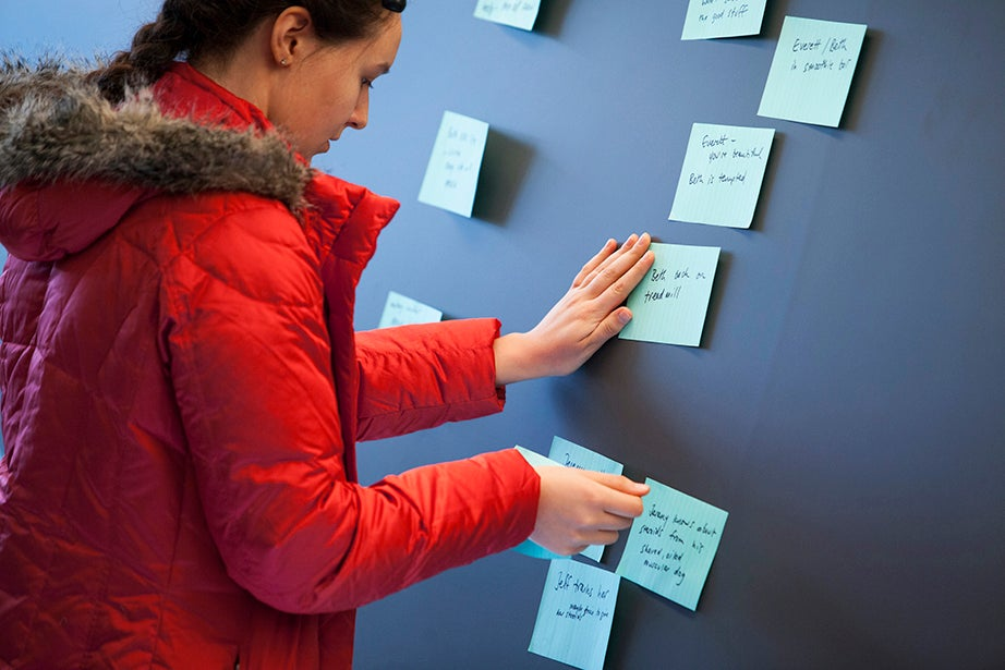 "Rachel Stromberg (pictured) sifts through story ideas during ""The Writers' Room: Writing for Television,"" a seminar with Greg Daniels '85 (""The Office,"" ""Parks and Recreation,"" ""King of the Hill""). Stephanie Mitchell/Harvard Staff Photographer"