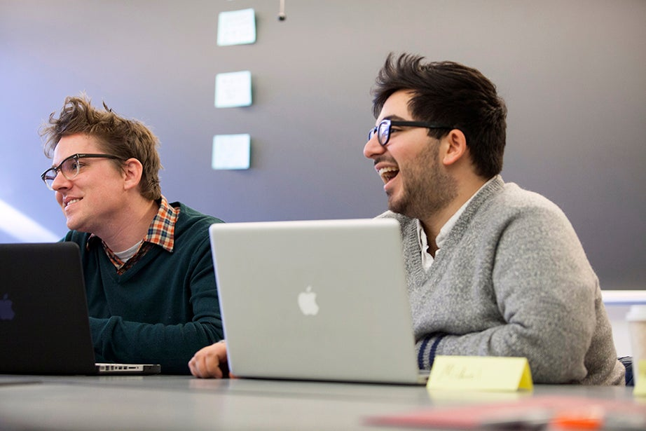 "Joseph Siara (left) and Michael Shayan laugh while discussing stories and pitching jokes during ""The Writers' Room"" seminar. Stephanie Mitchell/Harvard Staff Photographer"