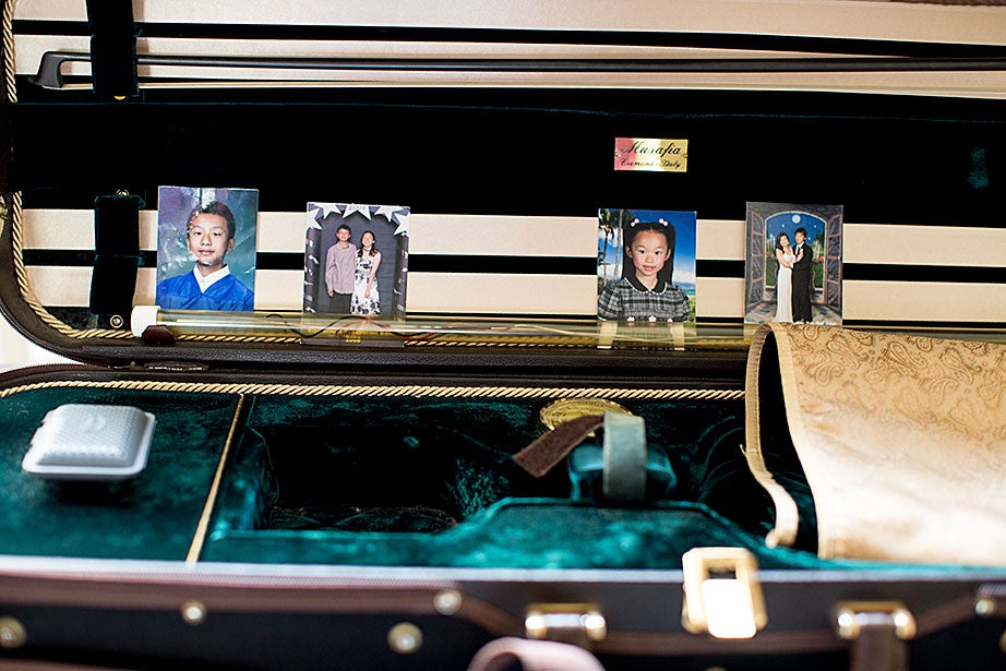 Photos of family and friends from Albert Li's hometown of San Jose, Calif., are posted in his violin case. His concentration is molecular and cellular biology.