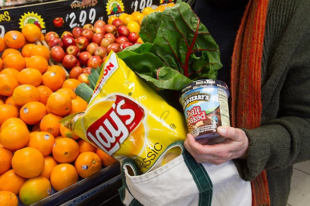 """Bringing reusable bags when grocery shopping has its upside, notes a Harvard Business School study, but there's also a downside. While shoppers are more likely to purchase organic and """"green"""" goods, they are also more likely to reward themselves with chips, cookies, and ice cream."""