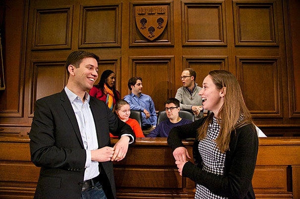 Last month, a handful of Harvard Law School students (pictured in Ames Courtroom at Harvard) headed to Washington, D.C., to work on cases bound for the U.S. Supreme Court. Eden Schiffmann (front left) worked with Caitlin Halpern (right) on a bank-fraud case. Schiffmann said the chance to meet with Kevin Loughrin, a plaintiff convicted in Utah of bank fraud and sentenced to three years in prison, was a high point of the clinic.