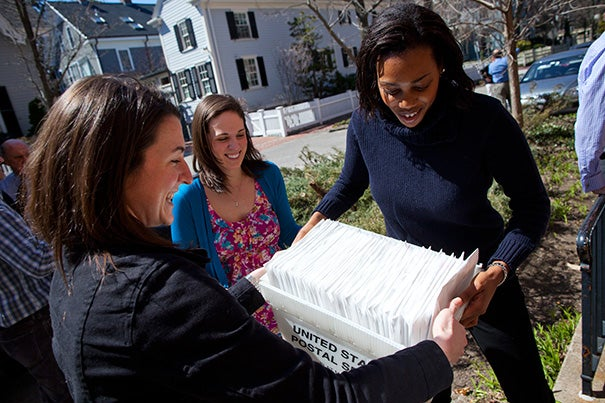 "Precious Eboigbe '07 (right), now a second-year law student at Boston College, said that with the Harvard Financial Aid Initiative, ""I was definitely less concerned about money."" Eboigbe spent three years as an HFAI student coordinator whose job, in part, included mailing the letters of admission."