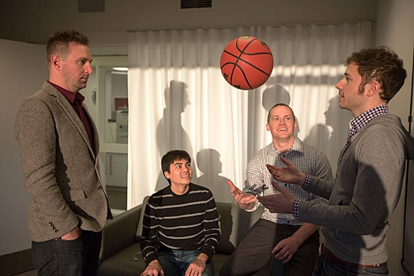 Luke Bornn (third from left), an assistant professor of statistics, is working with Kirk Goldsberry (far left), an associate of Harvard's Institute for Quantitative Social Science, and Ph.D. students Alex D'Amour (second from left) and Dan Cervone (right) to help basketball coaches and players evaluate the fraction-of-a-second decisions that happen on the court.