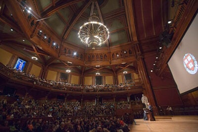 """Thank you for your children. They are remarkable people,"" said President Drew Faust in welcoming the parents of the Class of 2015 (photo 1).  Joining Faust in Sanders Theatre was interim Dean Donald Pfister, who encouraged the juniors to embrace the unique opportunities afforded them at the College (photo 2). Frederick Freyer '83 (from left, photo 3) and Jaye Freyer joined their son Jake '15 for the festivities."