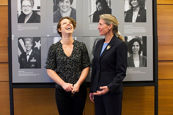 Sixty-six portraits of women who have made a difference through their inspiring work grace the hall of Harvard Law School's Wasserstein Hall in honor of International Women's Day. Second-year HLS student Maria Parra-Orlandoni (left, photo 1) stands with her nominee, Dana H. Born, a retired brigadier general. Ruth Bader Ginsburg (photo 2), U.S. Supreme Court associate justice, and Barbara R. Arnwine (photo 3), president and executive director of the National Lawyers' Committee for Civil Rights Under Law, are shown in portraits that will remain on display through March 14.
