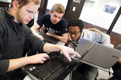 "Graduate students Aaron Kaufman (from left), Stephen Merity, and Kevin Kuate Fodouop crunch some numbers in Luke Bornn's (photo 2) class ""Statistics 183, Learning from Big Data."""
