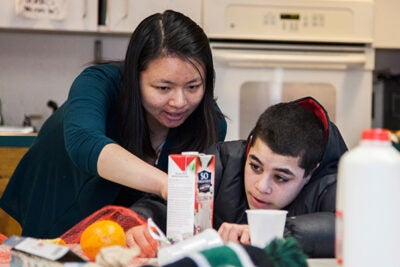 At a youth center in Cambridge, Harvard students brought science into the kitchen. Harvard junior Bonnie Lei (left, photo 1) and Dennis Friendly-Akers compared the composition and taste of various dairy and non-dairy milks, while Prerna Bhat (right, photo 2) and Jahmaya Adamson did the same thing, starting with cow's milk. Sicheng Wu wanted the taste of fresh juice so he made his own (photo 3).