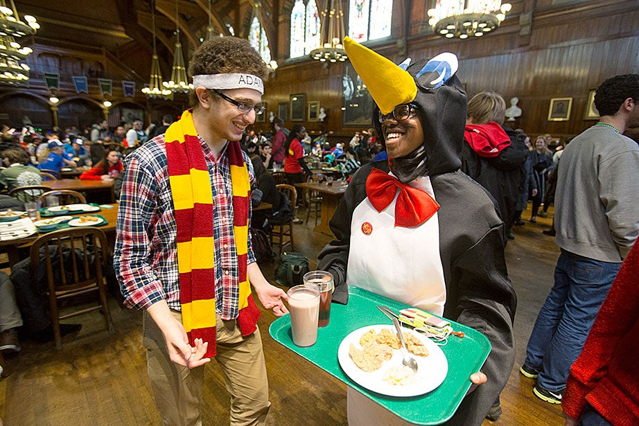 Yacine Fares '15 (left) of Adams House isn't afraid to talk to a rival penguin from Quincy, Saheela Ibraheem '15. Jon Chase/Harvard Staff Photographer