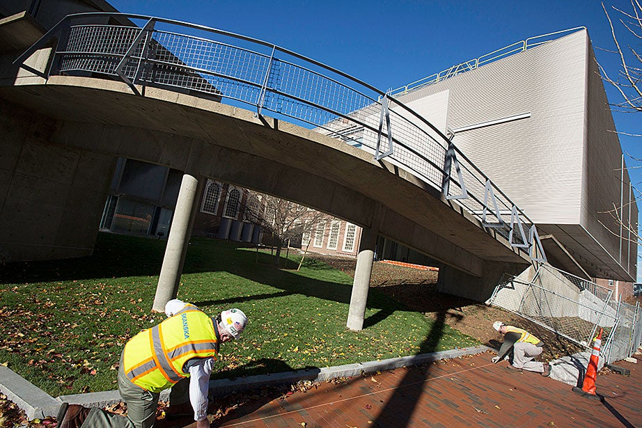 The newly renovated Fogg Art Museum and Fine Arts Library is measured for a bike rack while undergoing construction.